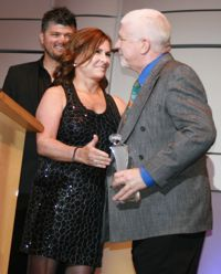 Andy Armstrong accepts  Jennifer Caputo's stunt woman of the year