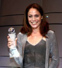 Yancy Butler with her Action Icon Award