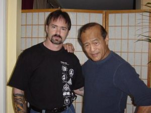 Mark with Dan Inosanto while directing his daughter, Diana, in Sensei