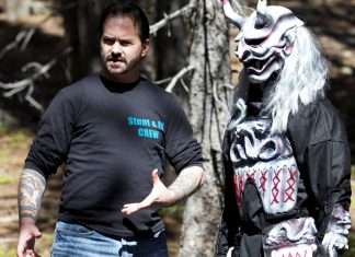 Mark Grove discusses scene with stunt fighter.
