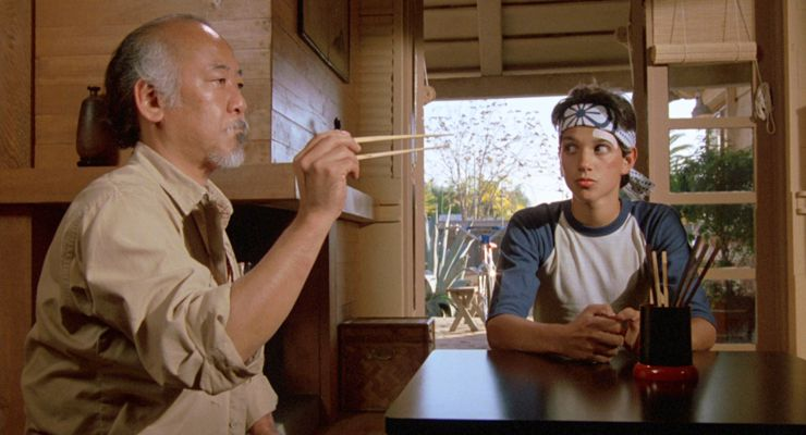 Pat Morita as Mr. Miyagi and Ralph Macchio as Daniel in The Karate Kid (1984)