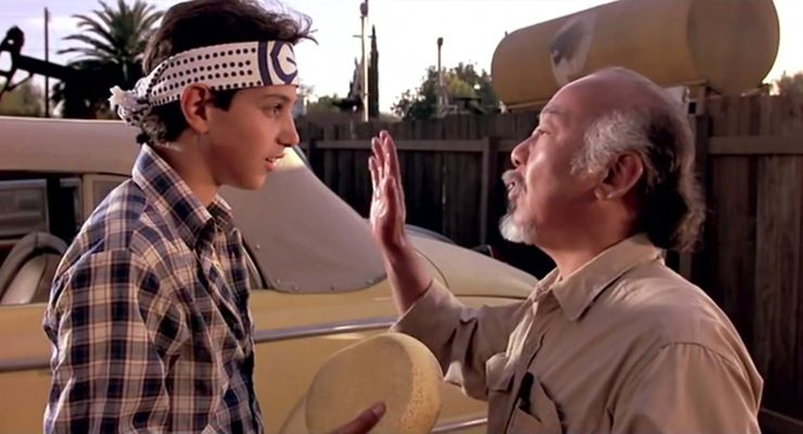 Ralph Macchio as Daniel and Pat Morita as Mr. Miyagi in The Karate Kid (1984)